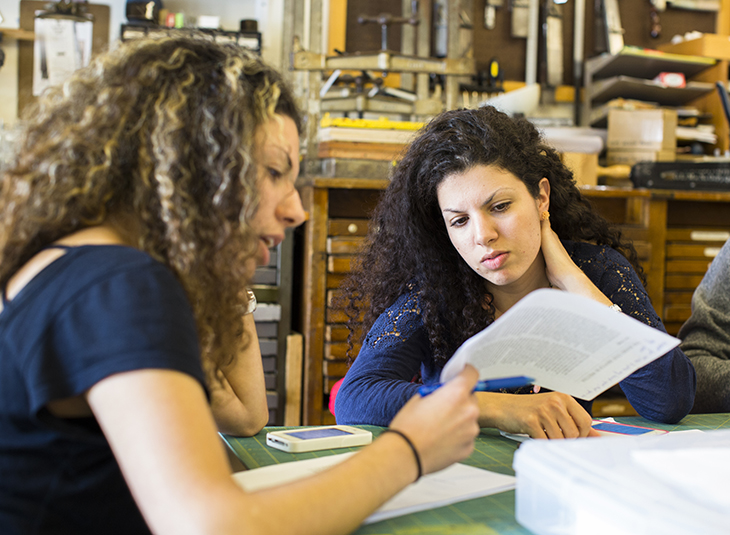two student discussing a paperwork